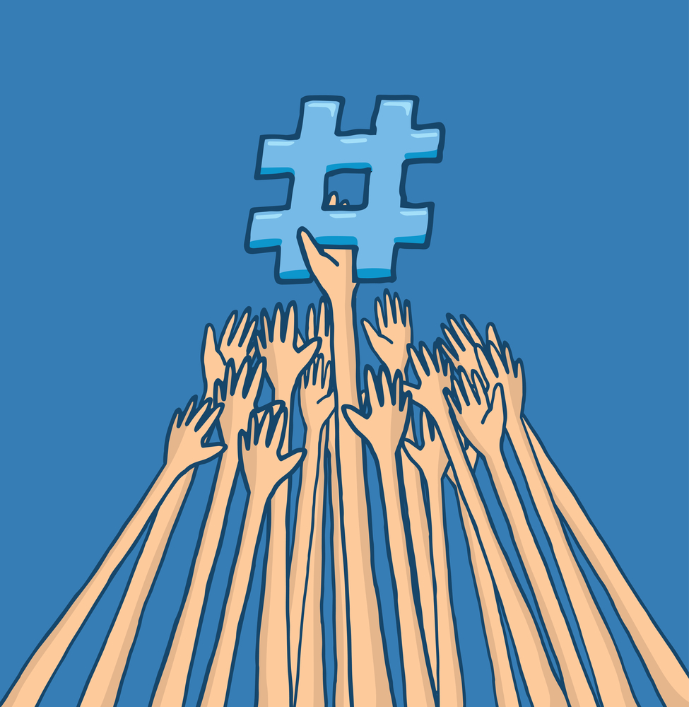 Hands struggling to reach trending topic hashtag